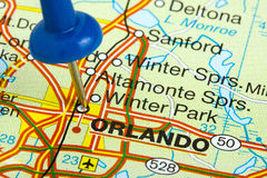 Pushpin in Orlando Florida Map. Orlando Florida highlighted with a blue push pin on an atlas or map Royalty Free Stock Images