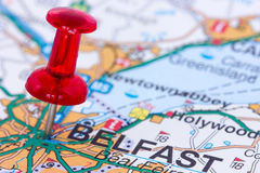 Pushpin pointing in Belfast. Red pushpin on the Northern Ireland map showing Belfast location Royalty Free Stock Image