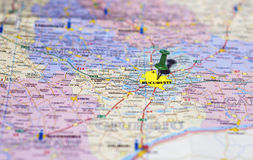 Pushpin pointing at Bucharest on a map. Pushpin pointing on map at Bucharest, capital of Romania Stock Photos