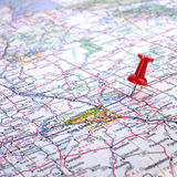 Pushpin in road map  Stock Images