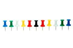 Pushpin row. Colour stationary pushpin on the white background row Royalty Free Stock Photography