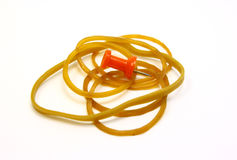 Pushpin and rubber bands Stock Photo