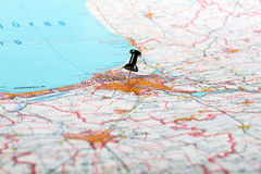 Pushpin showing destination point on a map Royalty Free Stock Images