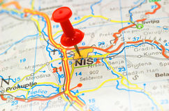 Pushpin stuck on a map. Nis - Serbia Stock Photo