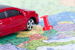 Pushpin and Toy Car on Map. Pushpin and small, toy car on map for travel concept Stock Photos
