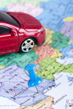 Pushpin and Toy Car on Map. Pushpin and small, toy car on map for travel concept Royalty Free Stock Photography