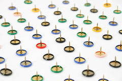 Pushpins. Arranged on a white background Royalty Free Stock Image