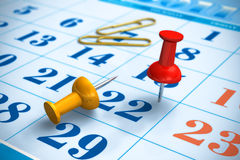 Pushpins and calendar Stock Photography