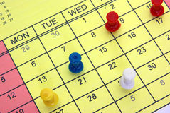 Pushpins on calendar Royalty Free Stock Photography