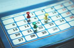 Pushpins on calendar. Concept of important day Stock Image