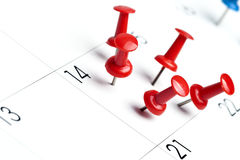 Pushpins on calendar. Important date or meeting appointment reminder concept. Copy space for text included Stock Photos