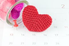 Pushpins on calendar and red heart. Selective focus Royalty Free Stock Image