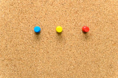 Pushpins on Cork board  as texture Stock Image
