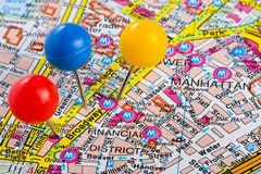 Pushpins in Manhattan New York Map. Three colored push pins in Manhattan Financial District city of New York Map stock images