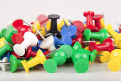 Pushpins. Pile of colorful pushpins isolated on a white background Stock Photos