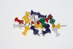 Pushpins or pushneedles. Colorful pushpins or pushneedles on white ground Royalty Free Stock Photos