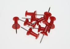 Pushpins or pushneedles. Red pushpins or pushneedles on white ground Royalty Free Stock Photo