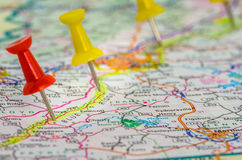 Pushpins on a Road Map. Pushpins Highlighting a Planned Trip on a Road Map Royalty Free Stock Photos