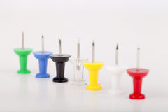 Pushpins. Row of colorful pushpins isolated on a white background. Space for text Royalty Free Stock Image