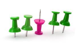 Pushpins verdes e cor-de-rosa Fotografia de Stock