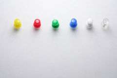 Pushpins and white paper Stock Photography