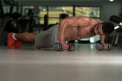 Pushups With Dumbbels Stock Photography