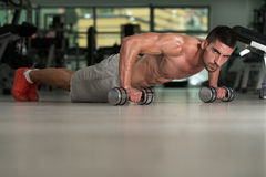 Pushups With Dumbbels Stock Photos