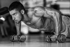 Pushups With Dumbbels Royalty Free Stock Photos