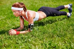 Pushups on grass Stock Image