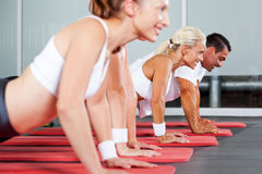 Pushups in gym Royalty Free Stock Photo
