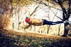Pushups with jump in nature. Young man exercise. Royalty Free Stock Images