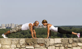 Pushups on a stone wall Royalty Free Stock Photo