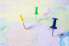 Puspoint on a map. Pushpin showing the location of a destination point on a map Stock Image