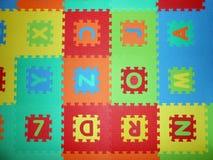 Pussel av bokstäver Arkivfoto