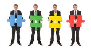 pussel för folk för jigsaw för holding för affärsgrupp Fotografering för Bildbyråer