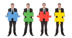 pussel för folk för jigsaw för holding för affärsgrupp Royaltyfria Bilder