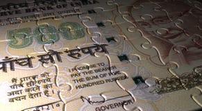 Pussel för indisk rupie Arkivbilder