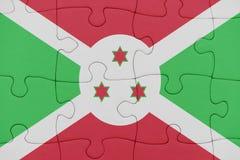 Pussel med nationsflaggan av Burundi arkivbilder