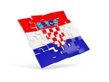 Pusselflaggan av Kroatien isolerade på vit Arkivfoton