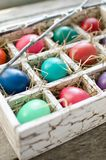 Pussy willows and Easter eggs in a box on old wooden table. Willow twigs and Easter eggs in a wooden box on an old wooden table Stock Photos