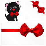 Pussycat and red gift bows. Stock Photography