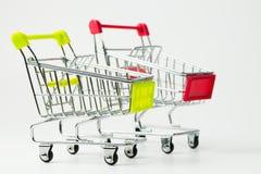 Pusta czerwień i żółci kolorów wózek na zakupy Zdjęcie Stock