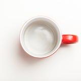 Pusta czerwona kawa, herbaciany kubek, filiżanka, odgórny widok na bielu Obrazy Stock