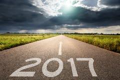 Pusta droga nadchodzący 2017 przeciw dużej chmurze Fotografia Royalty Free