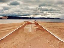 Pusta droga pokrywająca piaskiem fotografia royalty free