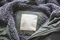 Pusta etykietka na kurtce Bawełniana etykietka kurtka z wełną Obraz Stock