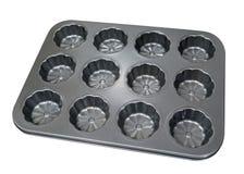 Pusta metalu słodka bułeczka babeczki taca dla piec odizolowywam na białym bac Fotografia Stock