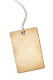 Pusta stara papierowa metka lub etykietka odizolowywający dalej Fotografia Stock