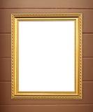 Pusta złota rama na cement ścianie Obrazy Royalty Free