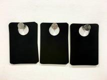 Puste czerni etykietki Na biel ścianie Obrazy Royalty Free